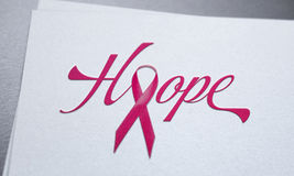 Breast cancer pink ribbon concept on white paper Stock Images