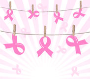 Breast cancer pink ribbons on rope Royalty Free Stock Image