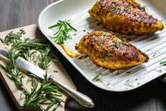 Breast of chicken fried with spices Stock Photo