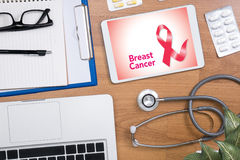Breast Disease Breast Cancer. Professional doctor use computer and medical equipment all around, desktop top view royalty free stock images