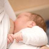 Breast feeding. Mother is breast feeding a newborn baby Stock Photo