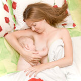 Breast feeding baby in bed Royalty Free Stock Photo