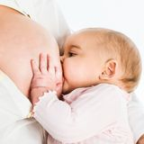 Breast feeding baby Royalty Free Stock Image