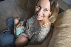 Breast feeding baby Stock Image