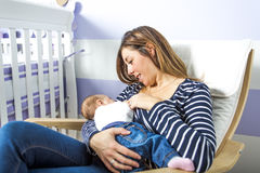 Breast feeding baby. royalty free stock photography