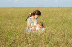 Breast feeding in the nature Stock Image