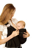 Breast-feeding in sling Stock Photography