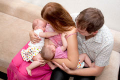 Breast-feeding twin babies at home Stock Photography