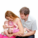 Breast feeding two little sisters twin girls Royalty Free Stock Images