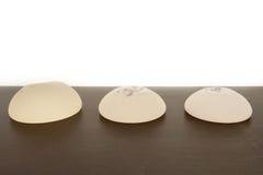Breast Implants. Various sizes on White background Stock Photos