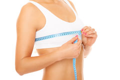 Breast measure. Women measures size of breast over white background royalty free stock photos