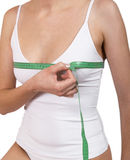 Breast measurement. Young girl using measure tape around her chest Stock Photos
