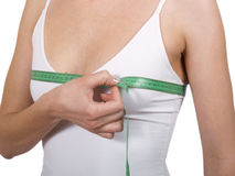 Breast measurement. Young girl using measure tape around her chest Stock Image