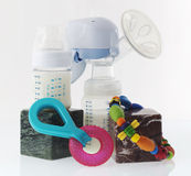Breast pump. With some toys Stock Images