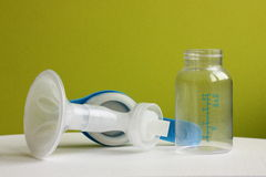 Breast pump. Hand breast pump with milk bottle Stock Image