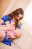 Breastfeeding. Young beautiful mother breastfeeding her 8 months old daughter stock photography