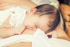 Breastfeeding of infant Stock Photos