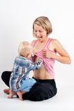 Breastfeeding woman and child Stock Image