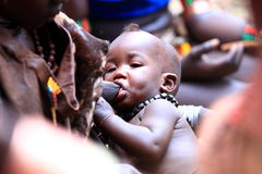 Breastfeeding. A woman from the Omoro tribe in Ethiopia breastfeeding her child Stock Photos