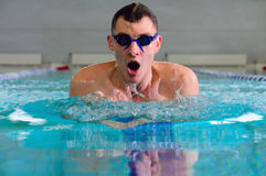 Breaststroke in indoor pool Royalty Free Stock Images