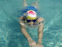 Breaststroke via wave Stock Photos