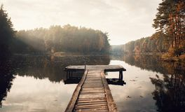 The Breath Of Autumn. Fog lake in morning with boat dock royalty free stock images