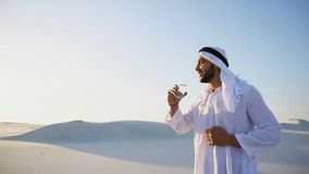 Breath of freshness of male Muslim in middle of dry climate of s royalty free stock images