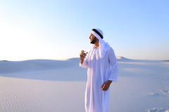 Breath of freshness of male Muslim in middle of dry climate of s Stock Image