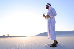 Breath of freshness of male Muslim in middle of dry climate of s Stock Photography