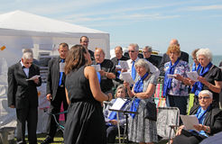 Breath of life choral singers. Photo of breath of life choral singers for charity singing at the tankerton slopes fun day in whitstable kent england on 22nd june Royalty Free Stock Photos