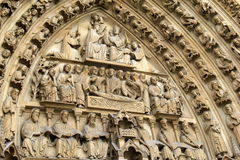 Breath-taking detail in stone carvings of apostles over doors, Notre Dame Cathedral,Paris,France,2016 Royalty Free Stock Photo