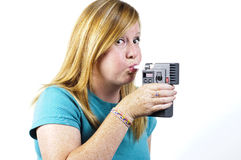 Breath test. A woman blowing into a police breath test machine Royalty Free Stock Photos