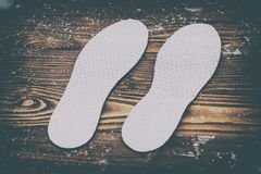 . Breathable insoles for shoes on wooden background. have toning royalty free stock photos