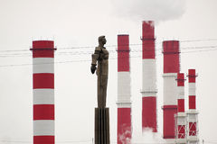 Breathe deeply. Gagarin and pipe thermal power plant Royalty Free Stock Photography