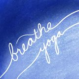 Breathe yoga in white letters on blue background, inspirational or motivational handwritten message about exercise and relaxation. Breathe yoga written in white royalty free stock photography