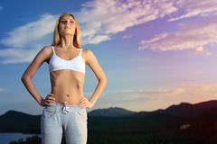 Breathing. Slender young woman doing yoga exercise outdoors Stock Photos