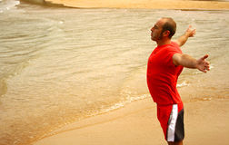 Breathing in the beach. An image of a man doing exercise and breathing in the beach Royalty Free Stock Photo