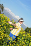 Breathing freely. Older woman celebrating the bliss of retirement while walking outside Stock Images