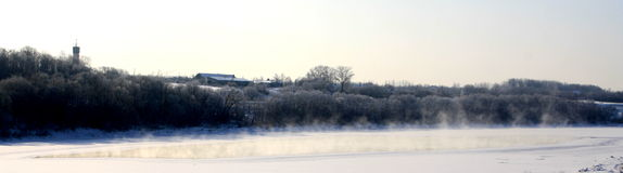 Breathing river. In winter. Stem coming up form water. Beautiful landscape royalty free stock photography