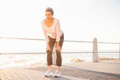 Breathing sporty woman resting at promenade Stock Photo