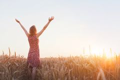 Breathing, woman with raised hands enjoying life. Breathing, woman with raised hands enjoying sunset in the field stock photography