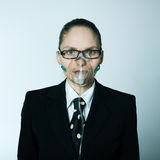 Breathless business woman. Studio shot portrait of one caucasian young breathless business woman  with oxygen mask Stock Photo