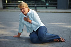 Breathless woman on sidewalk Royalty Free Stock Photos