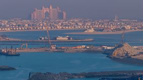 A breathtaking aerial view of the Palm Jumeirah during sunrise timelapse from a rooftop, Dubai, United Arab Emirates. Aerial view of Palm Jumeirah during sunrise stock footage