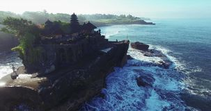 Breathtaking aerial view of of Tanah Lot Temple. stock video