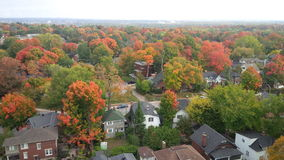Breathtaking Autum Colors landscape photo from highrise. Landscape photo from high panoramic view  of fall foliage lots of maple trees Stock Photo