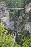 Breathtaking bridge. Small pedestrian bridge over a canyon in the Bavarian Alps stock photography