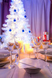 Breathtaking Christmas table setting with blue and white decoration Stock Images