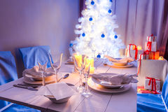 Breathtaking Christmas table setting with present and tree Stock Images