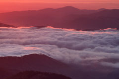 Breathtaking cloud sea at sunrise - dawn, Ceahlau Mountains, Romania Royalty Free Stock Photography